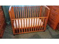 Lovely solid wood cot/toddler bed.
