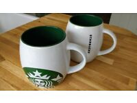 Pair of Starbucks mugs