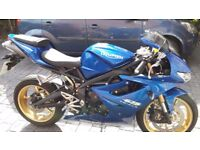 Electric blue colour, very fast bike. Never been out in the rain hence the low mileage!