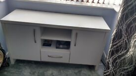 tv stand with storage cupboards. white mesuearing 117cm long side x 62cm high x 39 cm deep.