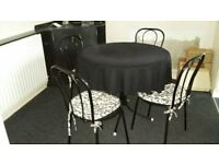 Free: Bistro table and four chairs