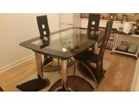 Black Glass & Chrome Boat Dining Table (Harveys) & 4 Black Leather Chairs
