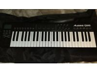 Alesis QX49 Midi keyboard with a stand and a bag