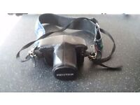 Vintage Pentax camera with case and strap