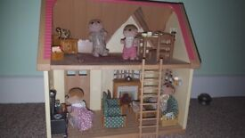Sylvanian Families Cosy Cottage with meerkat family and furnished with accessories