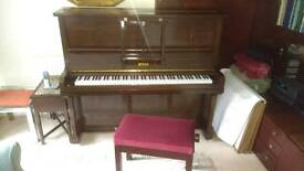 Steck upright piano and seat.