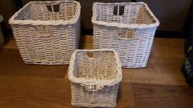 3 white wicker baskets