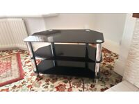 Black glass and silver TV stand