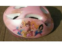 Princess Hello Kitty and cosmic bike helmet
