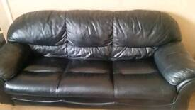 Black leather sofa with 2 armchairs