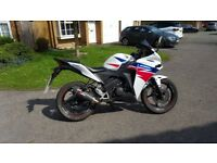 Honda CBR125 with Scorpion exhaust