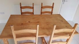 Homebase Pine Dining Table and four matching chairs.
