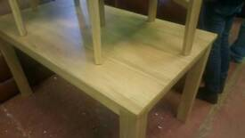 Oak new in box 4 seater dinning table and chairs