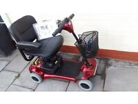Little used burgundy Roma Corella mobility scooter.