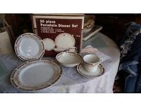 Beautiful porcelain dinner set with matching tea set