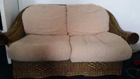 Wicker and cream sofa