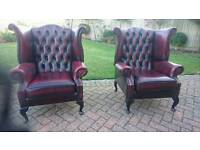 1 of 2 ox blood red leather Chesterfield wing chairs in excellent condition
