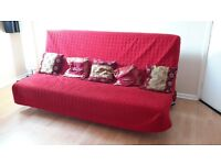 3 seater Ikea sofa bed with a red cover