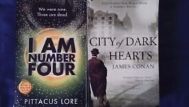I Am Number Four and City of Dark Hearts paperback books