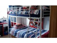 White metal bunk beds, no mattresses. Great condition