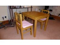 Childrens wooden table and 2 x chairs, would suit up to 6-7 year olds.