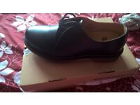 size 9. black shoes dr. martens.