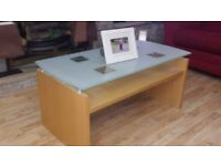 Glass topped nice coffee table. I can also arrange delivery if required.
