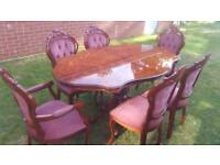 Italian rococo dining table and 6 chairs
