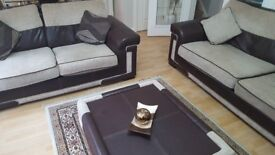 4 and 2 seater fabric and leather sofa with matching foot stool in good condition