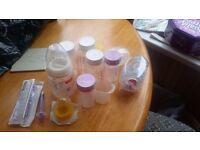 Selection of baby bottles and dummies