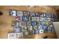 PlayStation 2 with loads of games and 2 consoles