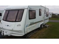 6 BERTH 2003 TWIN AXLE COMPASS SPACIOUS FAMILY VAN. CRIS REGISTERED TWIN BEDROOMS WITH ACCESSORIES.