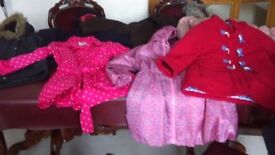 8 pairs of girls coats/jackets. Fits age 6-9. From Next, Debenhams, M&S. Worth well over £150