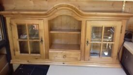 Solid Pine glass fronted wall cabinet
