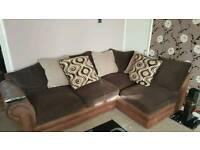 Brown fabric corner sofa and foot stool