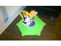 Fisher Price Bounce and Spin zebra activity toy.