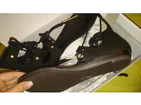 Gorgeous black and gold size 5.5 sandals brand new from Aldo