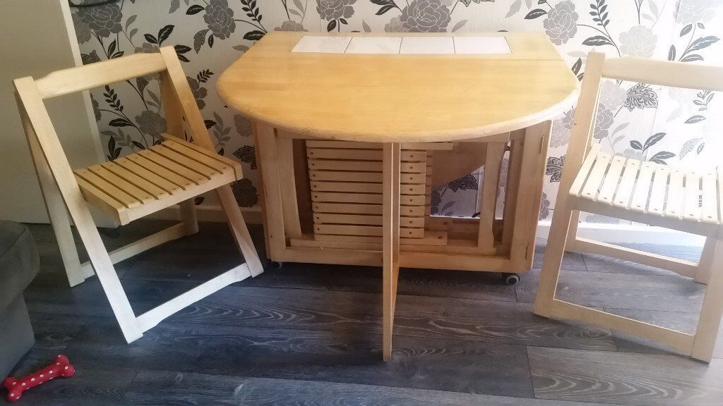 Drop Leaf Dining Table With 4 Folding Chairs Stored Inside In