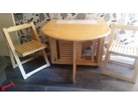 Drop Leaf Dining Table with 4 Folding chairs Stored Inside