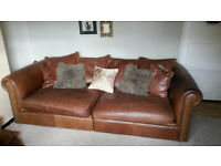 Large brown leather three seater sofa