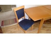 Extending Italian dining room table and 5 chairs.