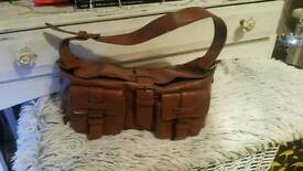 Tan hand bag