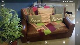 2 2 seat John Lewis vintage distressed sofas. ( throws and cushions not included)