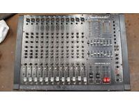 Studiomaster mixer and Peavy speaker bins.