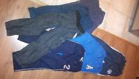 Eight pairs of Boys pants size 7