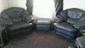 Blue leather 3piece suite comprising of 1 settee 2 chairs 1 pouffe.