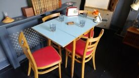 1950's formica and beech wood table and four chairs