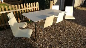 Extending cream and steel dining table and 6 cream leather and steel chairs