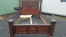 Large wooden framed king sized bed