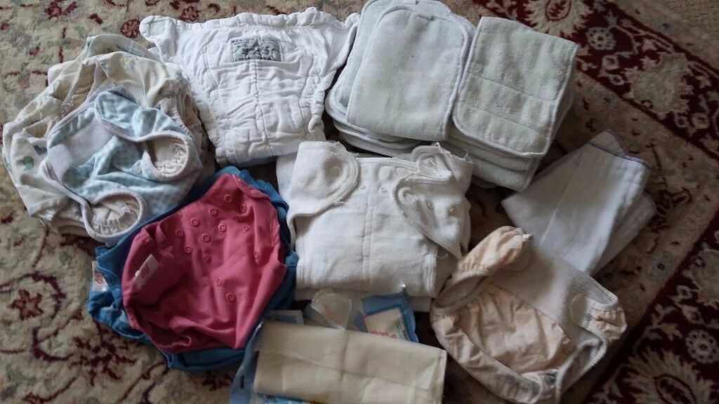 Bundle of baby cloth nappies and wraps